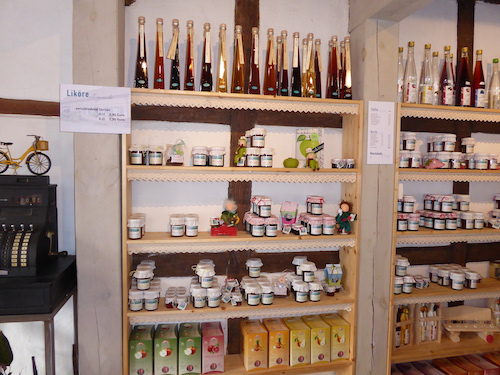 Shelf filled with homemade goods for take away.